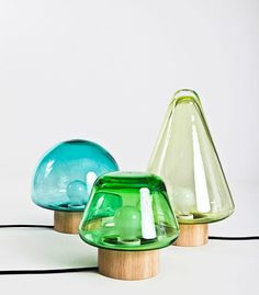 The Skog series consists of several lights in different sizes, shapes and colours, which can be used in combination with each other or as stand alone pieces. They are all made in mouth blown crystal with a base in oak made by using the technique of wood turning. The design is inspired by the large forests surrounding Magnor Glassverk. Skog is the Norwegian word for forest. Simply place a few of the lights together on the floor or on a table in order to create your own little forest.