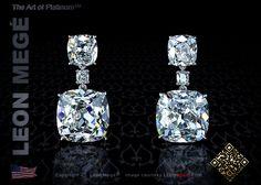 Drop earrings featuring antique cushion cut diamonds by Leon Megé
