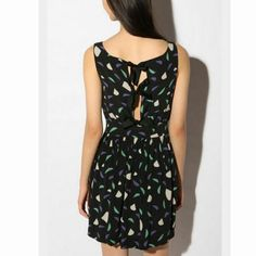 Super cute dress. Ties with three straps on the back. Brand new, without tags.