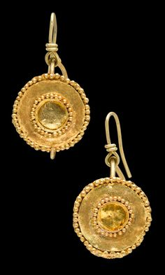 Jewelry Auction - Nov 30th 2016 - Hellenistic Bactrian gold earrings, mounted on removable modern gold earwires for wear. Wire hoops with frontal gold sheet discs, the edge encircled with granulation. Within, a concentric cricle of applied wire, also encircled with granulation. Intact goldwork would have originally contained enamel inlay, now lost. Tillya Tepe type, 3d - 2nd Centuries BC, Greek Afghanistan or Pakistan. This and more important art for sale on CuratorsEye.com
