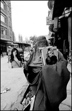 Larry Towell - Woman selling glamour magazines Kabul Afghanistan 2010