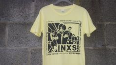 INXS. Love the Song names around the image. very simple one colour print , blocked out photo