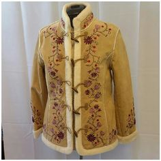 """Beautiful Embroidered Leather Coat Beautiful Embroidered Leather Coat. See pictures of tag and measurement.  Says Large but runs REALLY  Small,  more like a medium. 29"""" long, 24 """" sleeves,  18 1/2"""" across bust.  Never worn. Heavy. Warm. Gorgeous! Only Reasonable offers considered. Jackets & Coats"""
