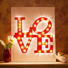 DIY Illuminated LOVE Canvas lit up... (I'd like to make a Christmas version)