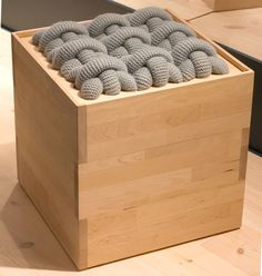 Sting by Aud Julie Befring brings together two of Norway's oldest traditions, embroidery and log building. The seat-slash-storage-box is made from birchwood with a double cross-stitch top in wool.