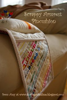 Scrappy Armrest Pincushion Tutorial.  Make it longer to go over the ironing board.