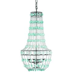 Beautiful sea glass chandelier is fabulous for a Key West cottage stairway entrance.