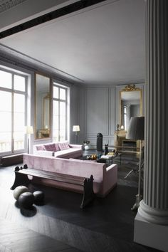 Parisian apartment glamour -- the dark floors and muted palette are moody, romantic, and sophisticated in this open plan living room.