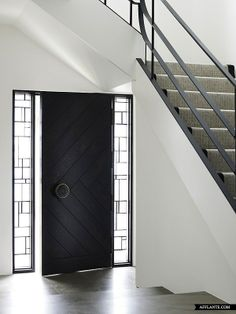 stunning sidelights, black door steel railing  Javens_Architects