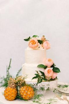 Pretty pink floral topped cake: http://www.stylemepretty.com/new-jersey-weddings/chesterfield-township-new-jersey/2016/02/02/garden-party-inspired-wedding-infused-with-pineapples/ | Photography: Michelle Lange - http://www.loveandbemarried.com/