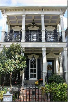 New Orleans inspired, love the iron balconies and gate.