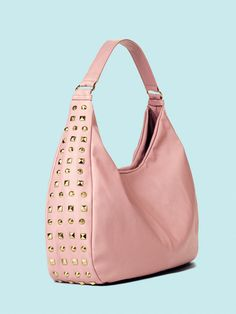 www.youravon.com/chele call it a tough cookie—this bag mixes soft pink with edgy studs!