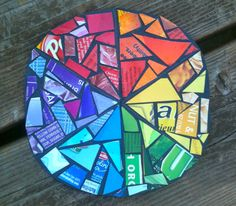 Magazine collage color wheel. Paint cardboard or chip board black. Glue magazine pieces.