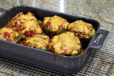Tried-and-True Stuffed Peppers with Ground Beef and Rice: Stuffed peppers with ground beef, cheese topping.