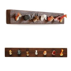 Witty and wonderful, the Pack Rack jewelry or key rack uses tiny plastic animal heads for hooks on wall-mountable black walnut salvaged from local cabinetry shops. Friends of the safari,tiger, elephant, antelope, zebra, lion, hippopotamus, and giraffe will guard your jewelry and keys.Comes wall-mount ready, packed in a gift box. Handmade in Brooklyn, New York by designer, Steph Mantis.