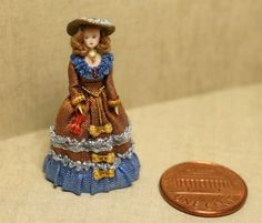 1:48 cloth and wood lady