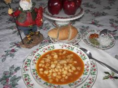 Menudo is a traditional robust, medium spicy Mexican soup with tripe, hominy, onions and spices. It's usually garnished with lime wedges, bowls of chopped chiles and onion and served with hot TORTILLAS.