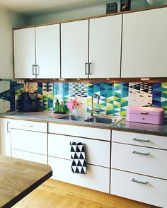 Love the wallpaper Pythagoras, and why not in the kitchen? Good idea!