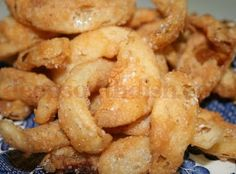 Deep Fried Sweet Vidalia Onion Strips - Strips of sweet Vidalia onions, dredged in buttermilk and seasoned flour, and deep fried to a crispy crunch.
