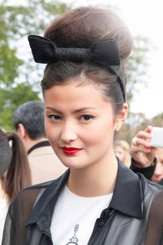 In Paris, a bun and a bow #streetstyle