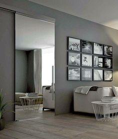 #Lifestyle #gris #grey | #Decoration_interieur #Interior_design | #Salon #living_room #sitting_room #lounge | La porte pivot s'agrémente d'un vitrage dépoli. Cette solution ouvre des perspectives étonnantes entre les espaces de vie, reflétant le jeu d'ombre et de lumière, à travers le verre. Les espaces sont démultipliés et les transitions entre les pièces imperceptibles. Les dimensions deviennent plus généreuses insufflant à la porte une 2nd fonction, l'esthétisme [©StainoStaino via…