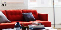 When everything else in the room seems dull, add a colorful punch with a bright red sofa.