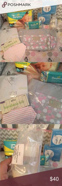 "Baby girl bundle No free shipping  No trades and no switching ""substitute"" (replacing things) 1 baby studio diaper bag 1 size 1 pampers swaddle and 1 papers clutch 1 bandana bib  1 halo sleep sack size small fits from birth to 6m 1 MAM bottle 2 Kiinde breastfeeding starter packs, can use for regular bottle feeding (there is a picture demo of what's in them) All new and sealed!  Baby, baby girl, Kiinde, MAM, diaper bag, baby stuff, bottles, diapers, pampers swaddle, halo sleep sack Other"