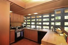 Buying a Frank Lloyd Wright original would be like trying to buy a priceless museum artifact.On Vashon you can live in a house inspired by his ideas for $374,000. Vashon Island, Usonian, Organic Architecture, Frank Lloyd Wright, Kitchen Cabinets, Cottage, Museum, Inspired, The Originals
