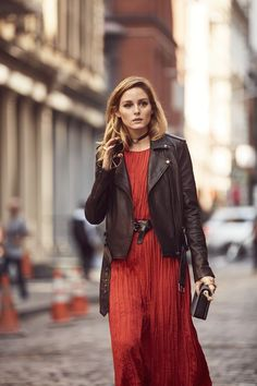 Olivia Palermo in black biker jacket and rusty red dress