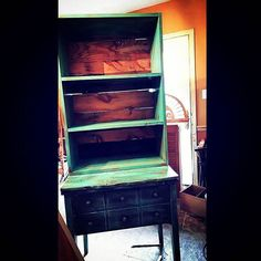 Antique sewing desk with hutch added on.  Pallet wood on back.
