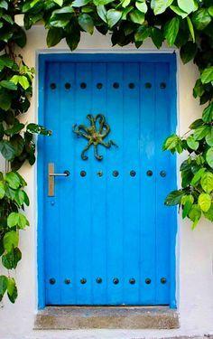 Cartagena, Colombia—vivid blue door with impressive large iron octopus door knocker