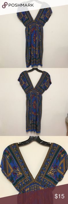 Rhapsody Dress or Cover-up. Size Small. Stunning blue, gold, and pink aztec-printed dress can be worn at the beach or at the club. Deep V-necklines in both back and front make a statement. It has an elastic waistband for comfort. Worn once - in pristine condition. Rhapsody Clothing - Size Small. Rhapsody Tops Tunics