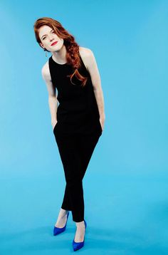 Rose Leslie from Game of thrones. Gorgeous red hair with side braid. Red lips black jumpsuit & blue heels. She's a cool chick