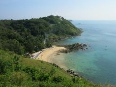Secluded and small Ya Nui Beach between Nai Harn Beach and Cape Phromthep.