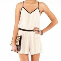 Beige Romper Beige lightweight flowy romper with black trim, and pleated accordion style bottom. I've worn this in the summer with black strappy wedges for a night out and in the winter paired with tights booties and a blazer, very versatile and always received many compliments. Easy to wear. Tobi Dresses