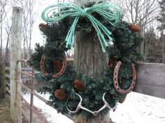 Rusty horseshoes, a bit, and twine used to decorate a wreath for the barn.