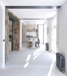 The lower ground floor of this existing four storey Edwardian Villa, in St. Johns Wood, London has been reconfigured with skinflints lighting by Architectural practise Threefold. Open Plan Kitchen, Kitchen Ideas, Turbulence Deco, Exposed Brick, Maine House, Industrial Chic, Architecture, Ground Floor, Interior Inspiration