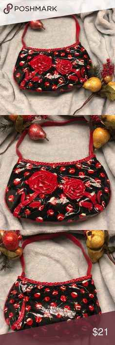 Vera Bradley comin up roses black & red purse Vera Bradley Frill Collection, Comin' Up Roses In Poppy Fields Pattern Small Shoulder Hobo Purse. Zipper top Closure with Frill Charm zipper pull. Opens to 1 open pocket. Fabric interior. 100% Vinyl coated cotton & PVC. Label marked: Vera Bradley made in China Vera Bradley Bags Hobos