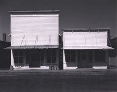 WRIGHT MORRIS, Two Store Fronts, Western Kansas, ca. 1939
