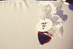 Instead of petal or rice toss, they had guitar picks! Guitar picks, people!