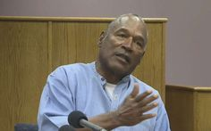 Former NFL football star O.J. Simpson appears via video for his parole hearing at the Lovelock Correctional Center in Lovelock, Nev., on Thursday, July 20, 2017. Simpson was convicted in 2008 of enlisting some men he barely knew, including two who had guns, to retrieve from two sports collectibles sellers some items that Simpson said were stolen from him a decade earlier.