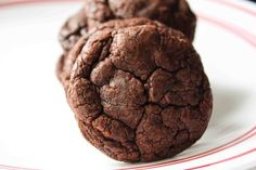 Brownie Mix Cookies 1 box brownie mix 3 tbs flour 2 eggs 1/3 cup oil Preheat oven to 350 degrees. Line cookie sheets with parchment paper. Drop rounded spoonfuls of dough on cookie sheets. Bake for 10-11 minutes.