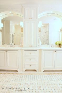 oh my! what a gorgeous white bathroom... his & hers vanities, countertop storage, basketweave pattern tile floors, marble... this bathroom has everything.