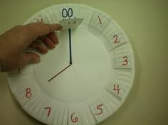 Paper Plate Clock- I suggest coloring in segments of time- quarter hour, half hour, ten minutes. Use paper fastener to spin!