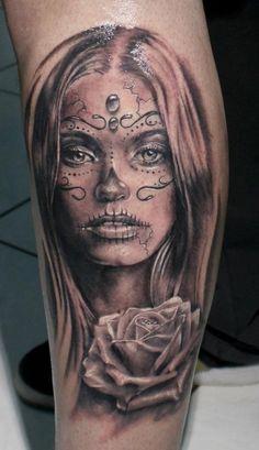Beautiful santa muerte girl with rose tattoo on leg
