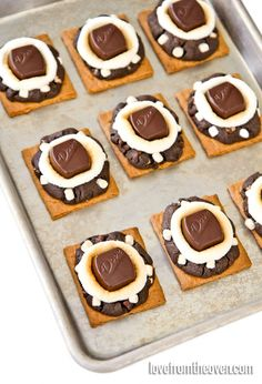 S'mores Cookies!  Dark chocolate cookies baked directly onto graham crackers - so delicious! #smores #chocolate #recipe