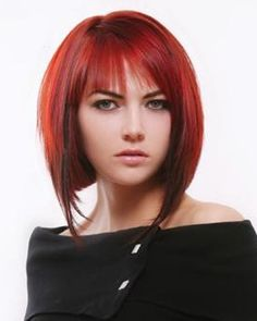 Lucious red bob style with bangs