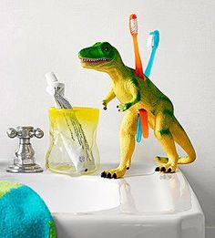 Teeth Rex! Fun way to display toothpaste & toothbrush! Toy With Your Decor: Teeth Rex (via Parents.com)Teeth Rex There will be more brushing and less whining, thanks to this easy project inspired by our friends at our sister magazine Family Fun. Use a craft knife to cut square holes (big enough to fit the bottom of a toothbrush handle) into a hollow plastic dinosaur.