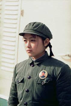 Nixon in China. Young Chinese girl dressed in soldier attire and a portrait pin of Mao at the arrival ceremonies at Beijing for the press plane during Nixon's trip to China. Feb. 21 1972.