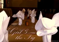 Tables napkins wine glasses girl and the fig restaurant Sonoma California